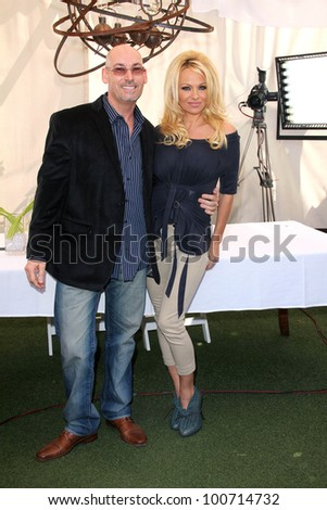 Julian Spitari, Pamela Anderson at a press conference for the New Online Social Platform FrogAds.com, Petit Ermitage, West Hollywood, CA 03-22-12 - stock photo