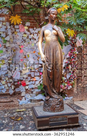 Juliet staue and wall with love notes, Verona, Italy - stock photo