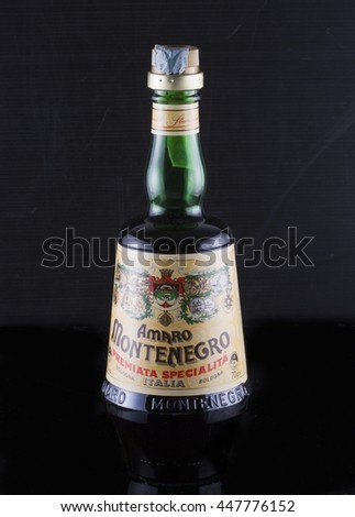 July 4, 2016: a bottle of Amaro Montenegro over black background. Typical Italian liquor. - stock photo