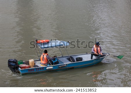 JULY 2012: A tourist boat cruising on Singapore river  in Singapore. Singapore river cruises are popular tourist attractions.  - stock photo