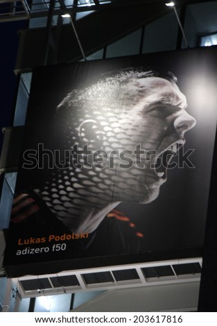 JULY 7, 2014 - BERLIN: a portrait of the German soccer player Lukas Podolski on a high rise building in Berlin during the football world championship 2014. - stock photo