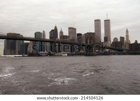 JULY 1995 - NEW YORK: the skyline of Manhattan with the Twin Towers of the World Trade Center and the Brooklyn Bridge, Manhattan, New York. - stock photo