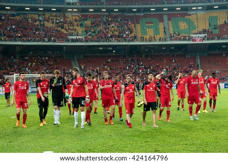 July 24, 2015 - Shah Alam, Malaysia: Liverpool FC's players and officials thank the fans and supporters around the stadium after their match against Malaysia. Liverpool FC from UK is on an Asia tour. - stock photo