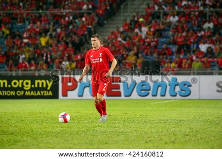 July 24, 2015- Shah Alam, Malaysia: Liverpool's James Milner dribbles the ball in a friendly match against the Malaysian Team. Liverpool Football Club from England is on an Asia tour. - stock photo