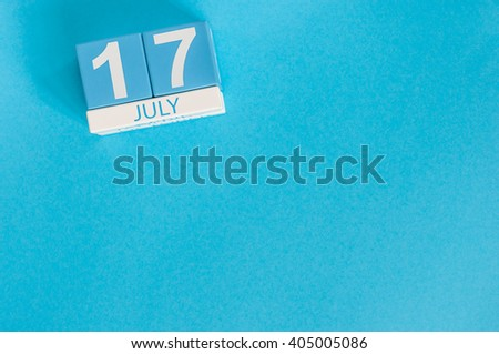 July 17th. Image of july 17 wooden color calendar on blue background. Summer day. Empty space for text - stock photo