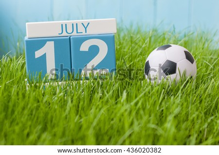 July 12th. Image of july 12 wooden color calendar on greengrass lawn background. Summer day, empty space for text - stock photo