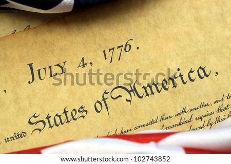 July 4, 1776 - United States of America Constitution and USA Flag. - stock photo