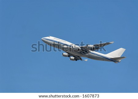Jumbo jet ascending after takeoff