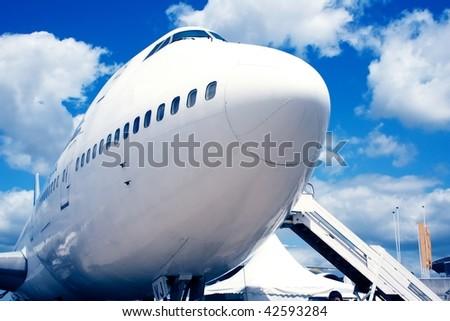 Jumbo jet stop in airport - stock photo