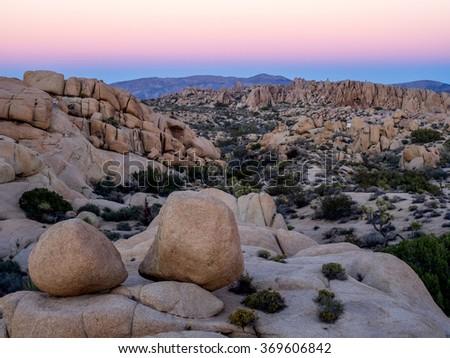 Jumbo Rocks after sunset n Joshua Tree National Park, California, USA, where the Mojave and Colorado desert ecosystems meet - stock photo