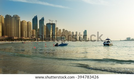 Jumeirah beach and Dubai Marina skysrapers at the sunset,Dubai,United Arab Emirates - stock photo