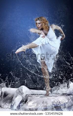 Jump of ballerina on the ice dancepool around splashes of water drops - stock photo