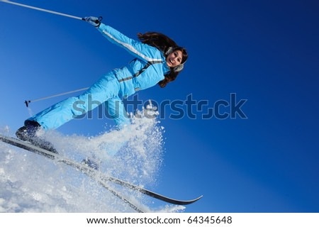 jump of happy young skier - stock photo