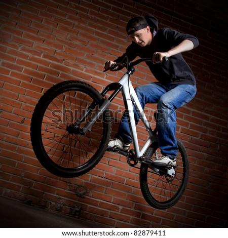jump on bike - stock photo