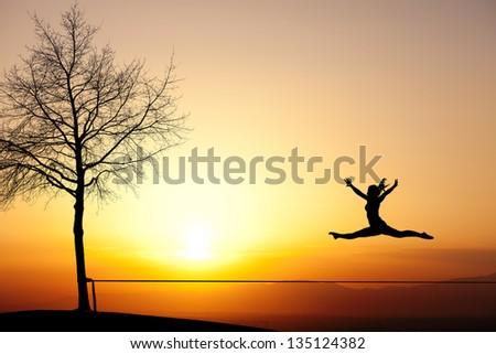 jump on slackline - stock photo