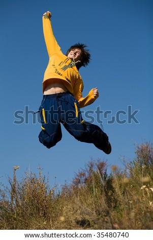 Jump over deep blue sky - stock photo