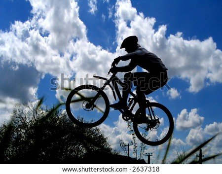 jump with a mountain bike and blue sky