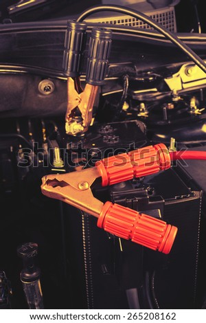 jumper cable for car battery in engine room - stock photo