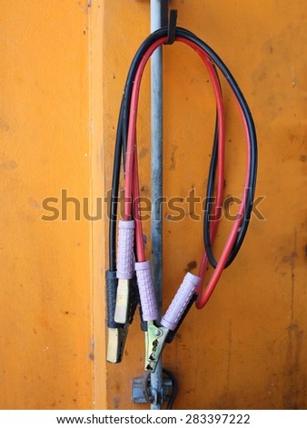 Jumper cables for jump starting a car - stock photo