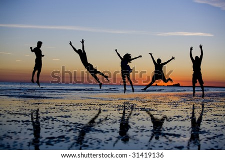 Jumping at Sunset - stock photo