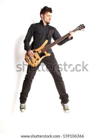 Jumping bass player on a white background - stock photo