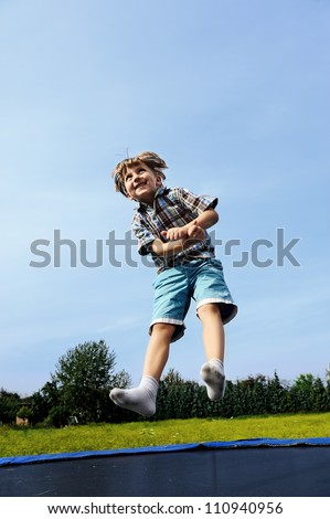 jumping boy against sky background - stock photo