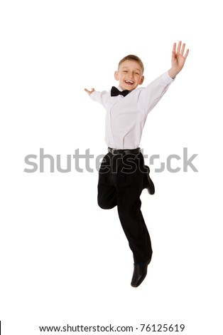 Jumping boy happy smiling isolated on white