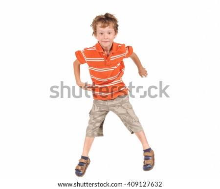 Jumping boy isolated over white background - stock photo