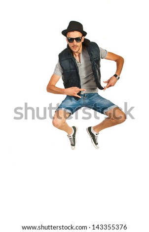 Jumping break dancer man with hat isolated on white background