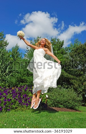 jumping bride with flip flops - stock photo
