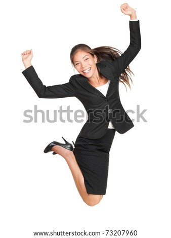 Jumping business woman. Celebrating successful businesswoman in suit jumping joyful isolated on white background in full length. Beautiful mixed race Asian Caucasian female model. - stock photo