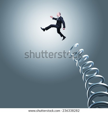jumping businessman and metal springer - stock photo