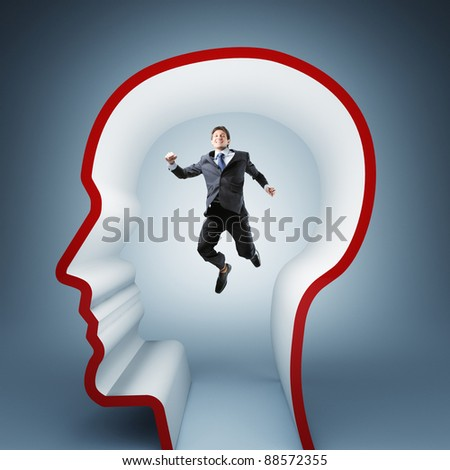 jumping businessman in 3d head