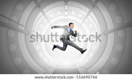 Jumping businessman in virtual room . Mixed media