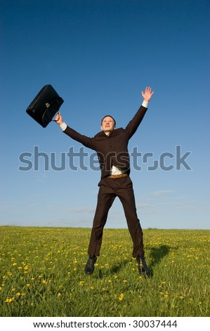 Jumping businessman with case - stock photo