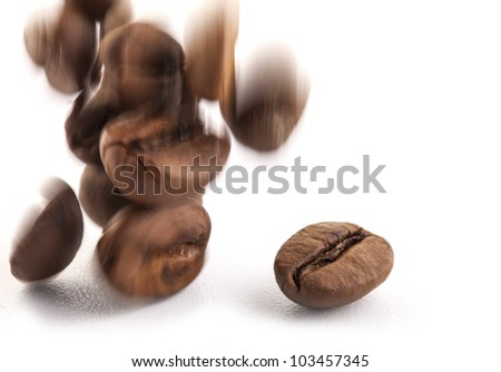 Jumping coffee beans, selective focus, isolated on white background