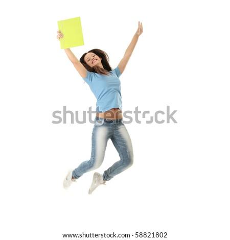 Jumping female college / university student isolated on white background. - stock photo