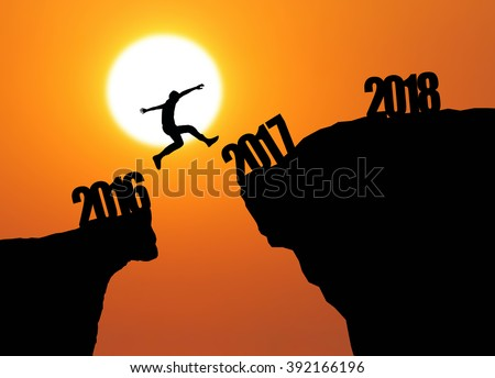 jumping from 2016 to 2017 and 2018 in sunrise background - stock photo
