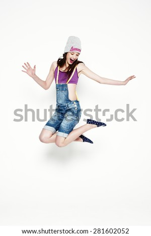 jumping girl isolated on a white background - stock photo