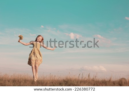 jumping girl outdoor - stock photo