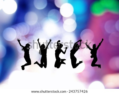 Jumping girls  on neon background. - stock photo