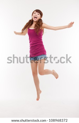 Jumping happy asian woman isolated on white background. - stock photo
