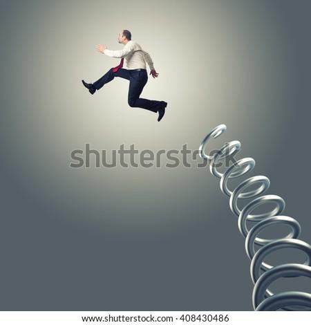 jumping man and metal springer - stock photo
