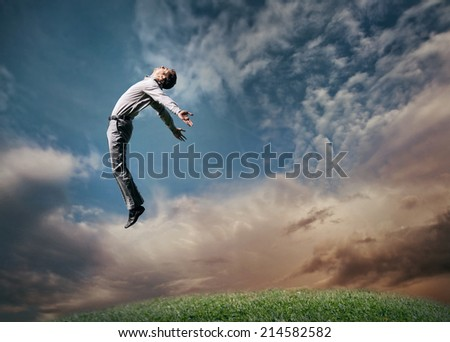 Jumping man in sky - stock photo