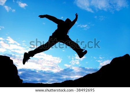 jumping man on a blue sky background