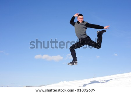 Jumping man with fun grimace isolated blue sky