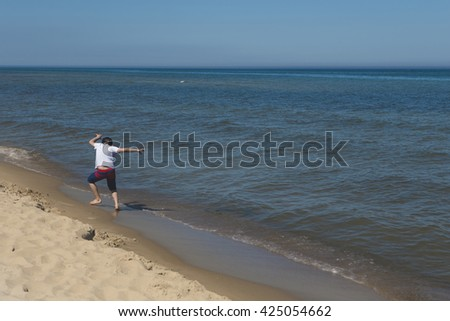 Jumping on a beach,having great time, good summer time, natural beauty