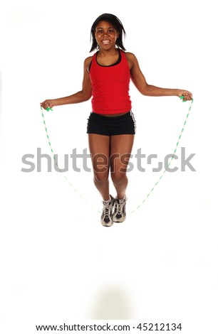 Jumping Rope. A small amount of motion blur from the jump... - stock photo