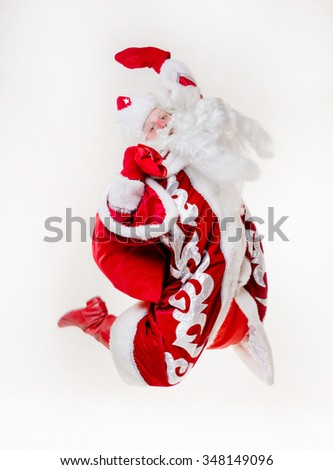 Jumping Santa Claus on white background. Isolated