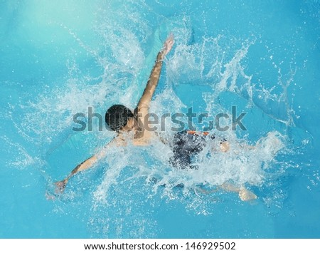 Jumping splash into the summer water pool